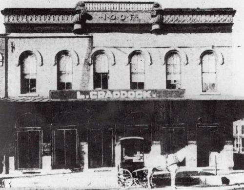 The first location, at Main & Austin, with theater on second floor (1880s)