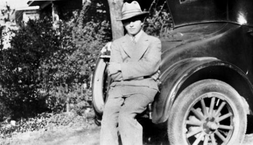 clyde-barrow_with-car_1926_utsa