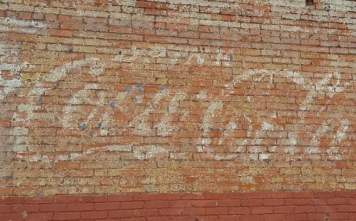 swiss-circle_coke-ghost-sign_070516