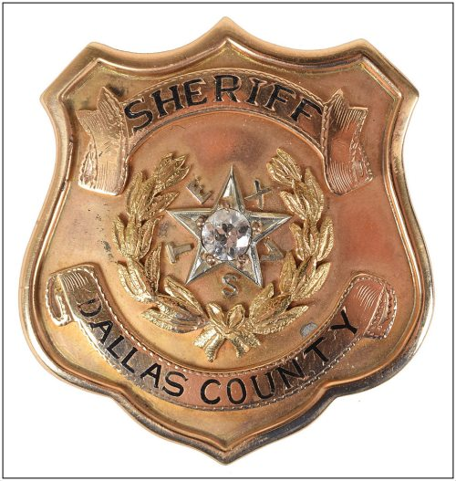 smoot-schmid_badge_front_rr-auction_june-2017